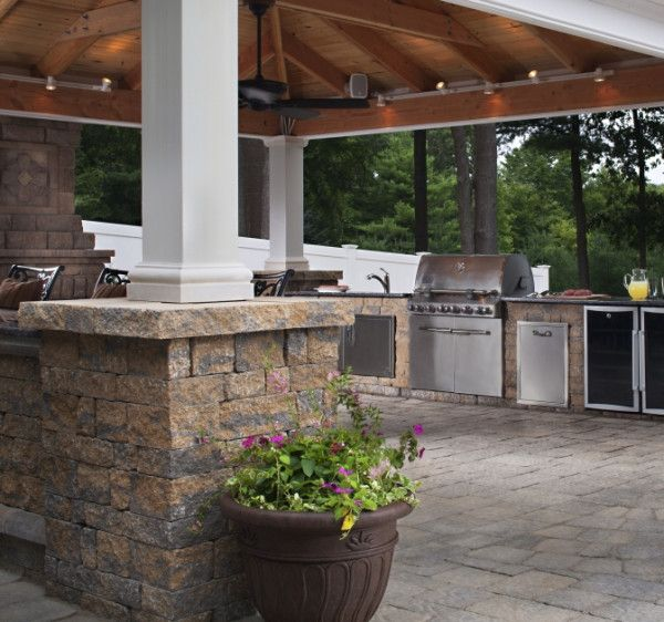 Equipped with a grill station, sink, refrigerator, lighting and speakers, this outdoor kitchen has it all.