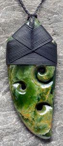 Bound Marsden Flower jade Maoru Toki by New Zealand Artists Ewan Parker and Wayne Turnbull.   www.boneart.co.nz