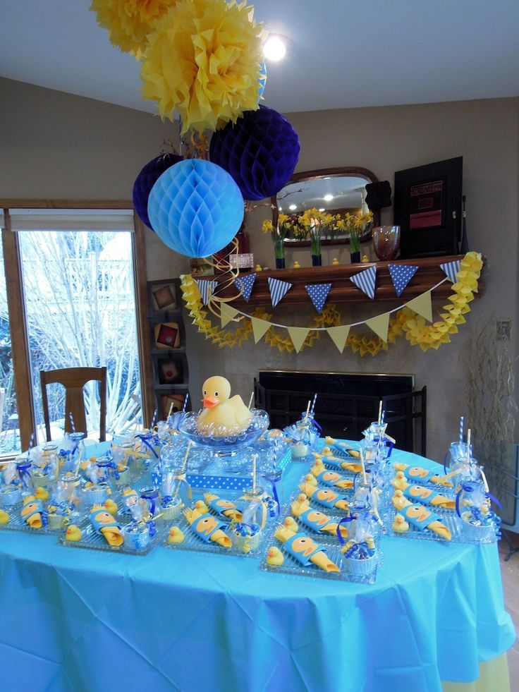 Serve yellow or orange drinks with blue punch. Like bubble bath party favors. Yellow roses in vases for decorations.
