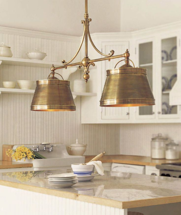 Warm metal fixtures are so big right now from antiqued for Brass kitchen light fixtures