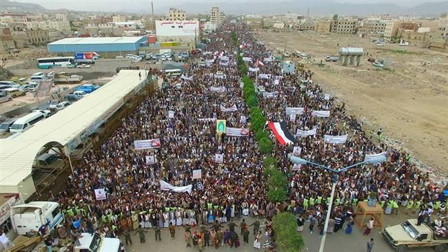 "Yemenis stage massive rally against US support of Saudi war on Yemen. The demonstrators marched through Ma'rib Street in central Sana'a after Friday prayers, carrying Yemeni flags and banners in condemnation of US President Donald Trump's upcoming visit to the Saudi capital Riyadh later this month.  Participants in the rally also shouted slogans such as, ""No to American terrorism,"" renewing the Yemeni people's steadfastness in the face of the Saudi aggression, which has been supported by the…"
