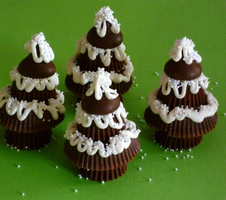 Peanut butter Christmas trees: peanut butter cups (snack and mini size), Hershey's kisses, white chocolate, and white non-pariels. Melt the white chocolate, it will be the glue.