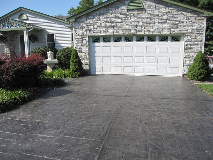 Bored of your old concrete driveway? Make it look as gorgeous as this with stamped concrete overlay. CALL (636) 256-6733 for more driveway options.  Decorative Concrete Resurfacing 715 Debula Dr Ballwin, MO 63021 (636) 256-6733