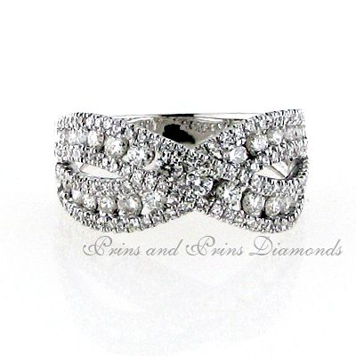 There are 153 = 1.72ct round brilliant cut diamonds channel and pavé set in an 18k white gold cross-over eternity ring