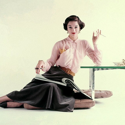 A sheer pink shirtwaist blouse and a bell-shaped skirt by Nelly de Grab, 1952