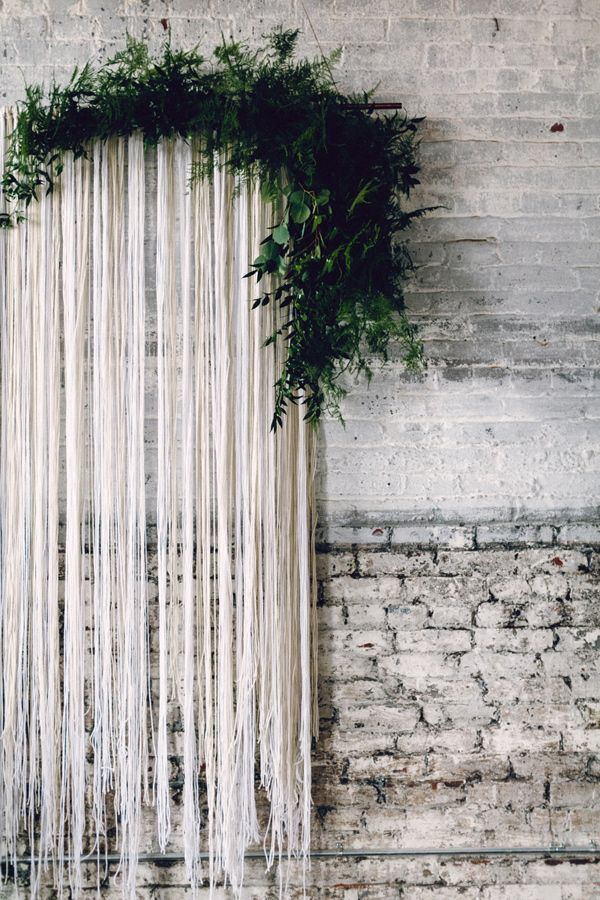 streamer backdrop with greenery - photo by Danfredo Photos + Film http://ruffledblog.com/nordic-industrial-wedding-inspiration #backdrops #backdropideas #weddingideas
