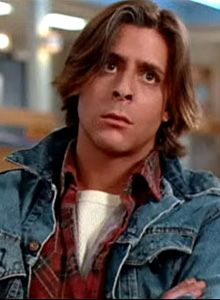 "Judd Nelson in the Breakfast club.  Jean jacket w/lumber jacket is what we used to call a ""Skid"" in highschool"