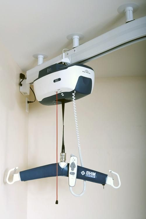 Various patient hoists, ceiling track hoists and mobile ...