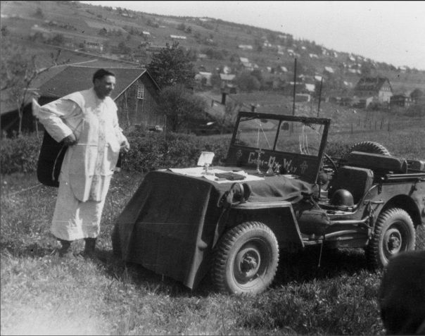 US Army Chaplain conducts his religious service from the good of a jeep named 'Going My Way', 3rd US Army, 87th Infantry Div., Europe, 1945