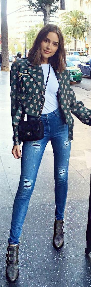 Who made Olivia Culpo's green print jacket, skinny ripped blue jeans, black buckle boots, and handbag?
