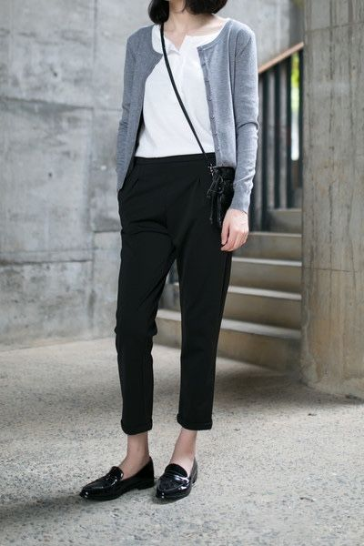 White henley t-shirt (tucked-in), black straight cropped trousers, gray cardigan, black loafers