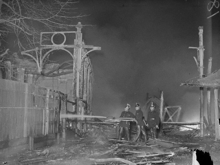 A photograph of firemen at the Crystal Palace fire, Sydenham, London, taken in November 1936 by Edward G Malindine for the Daily Herald.    After housing the Great Exhibition in 1851 the Crystal Palace was dismantled and rebuilt at Sydenham, south east London, reopening in June 1854. Fire broke out on the night of 30 November 1936. The fire was fought by eighty-eight fire engines and four hundred and eighty-three fire fighters from four different fire brigades. The cause was never found.