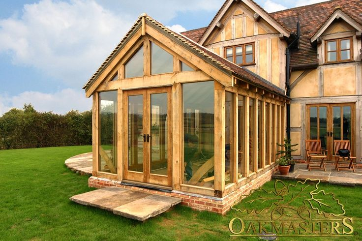 Exterior glazed gable and oak frame doors leading out of garden room built to match house