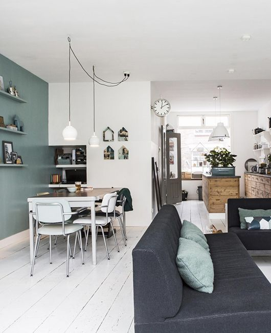 Cute living room combined with a vintage dining area and a rustic kitchen.