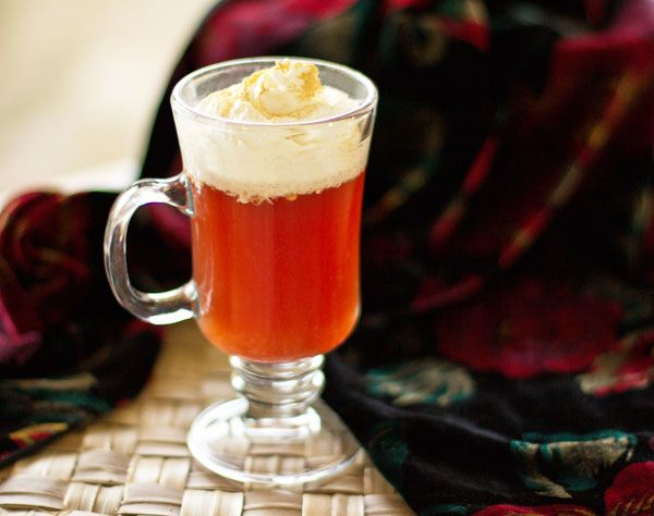 Rooibos chai brewed in cranberry juice, topping with whipped cream and ginger mjskitchen.com @MJs Kitchen