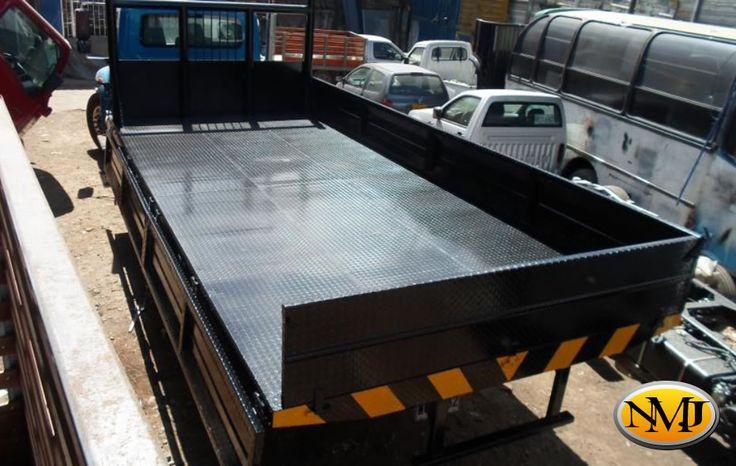 También ofrecemos una variedad de opciones en acero y cubiertas de madera para que pueda personalizar su Camión de Cama Plana.  http://www.carroceriasyfurgonesnmj.com/planchones-plataformas-cama-baja-cama-plana-nuevos-y-usados-bogota-colombia