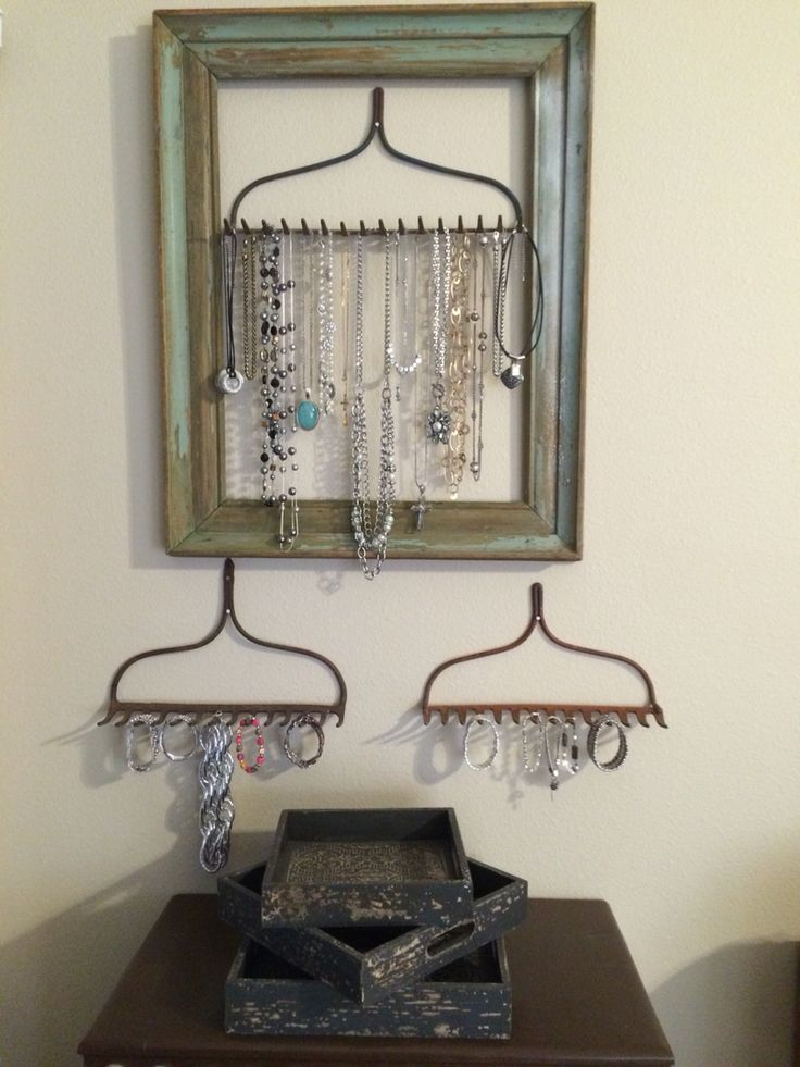 Jewelry storage/display using old rake heads and distressed picture frame!