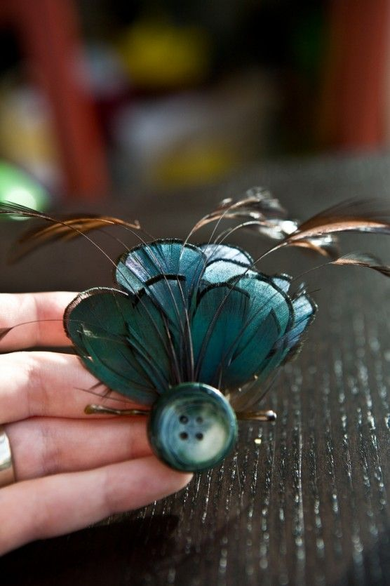 Feather hair clip (I'd make it with a different button that was more decorative or a fake jewel, & attach a clip so the bobbypin doesn't show. )