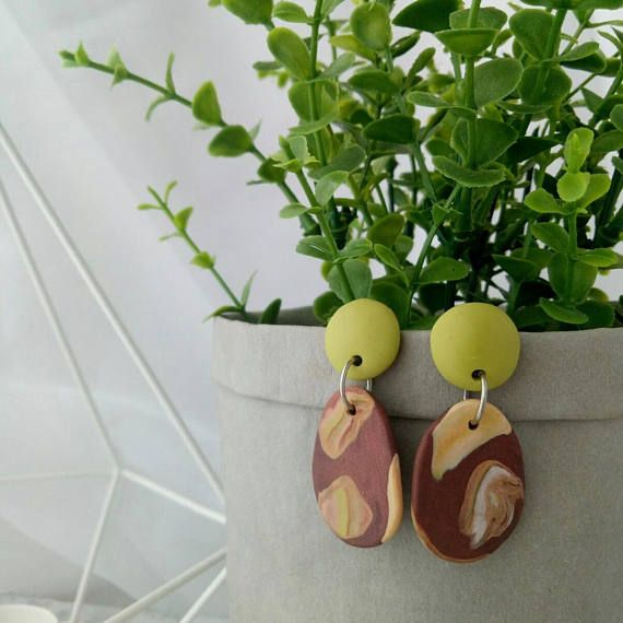 One-off polymer clay dangle earrings with muted green domed stud and bronze brown drop. Surgical steel posts. Measurements (appox) Total length 48 mm Stud diameter 15 mm Drop length 30 mm Drop width ( at widest point) 22 mm All tsom earrings are carefully handmade in Melbourne,