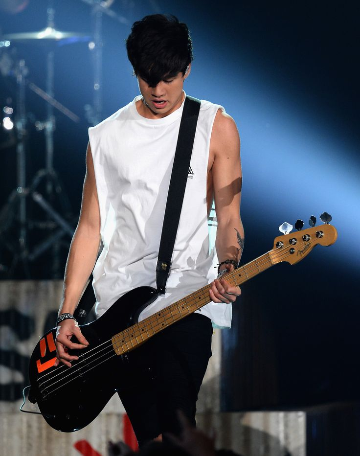 (HQ Please credit if you use) 5 Seconds of Summer performs onstage during the 2014 Billboard Music Awards at the MGM Grand Garden Arena on May 18, 2014 in Las Vegas, Nevada