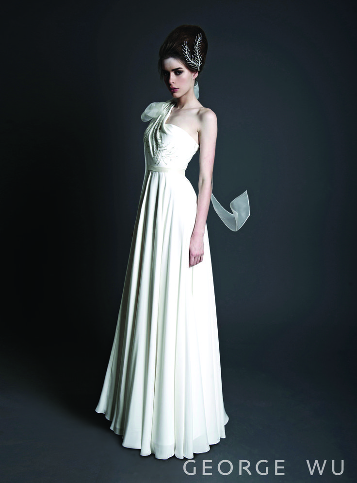 Aubesier Feather dress - silk crepe with hand embroidered feather shaped beading along the drape line. Made in Australia.  Repin for your own #wedding #inspiration.  #bridal #couture #design #gowns
