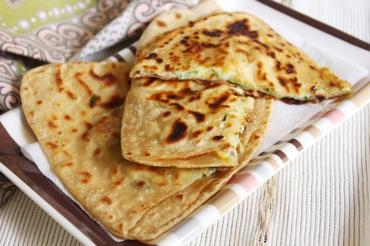 Egg Stuffed Paratha is a delicious and healthy Paratha dish, filled with egg mixture. Both the eggs and whole wheat are healthy as it provides the right amount of proteins and carbs. The egg mixture has finely chopped onions, green chili and coriander leaves. This is then slided into the half cooked paratha pockets and cooked further. The Egg Stuffed Parathas are quite filling in itself. Serve theServeEgg Stuffed Paratha Recipe, along with Tadka Raita or Dhaniya Pudina chu...