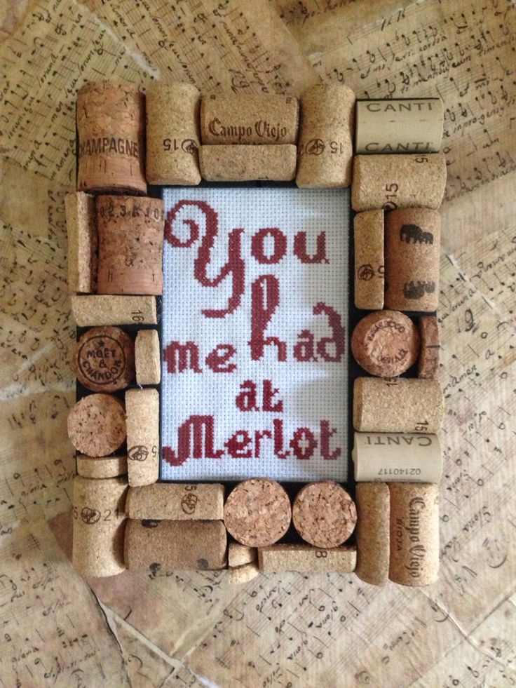 Upcycled cork frame with a wine pun cross stitch