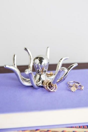 This elegant octopus ring holder.   37 Beautiful Household Items Every Ocean Lover Needs