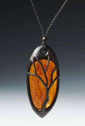 Tree necklace in bog oak and amber by Geoff King    Love the concept. Might try it in polymerclay.