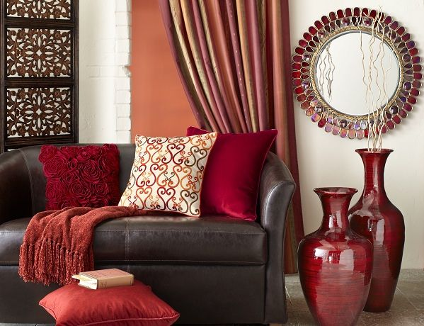 Leo Zodiac Pier 1 Alluring Mirror with Red Bamboo Vases and assorted pillows Red Living RoomsLiving Room IdeasFurniture