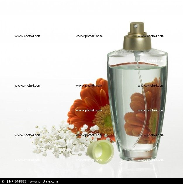 http://www.photaki.com/picture-bottle-of-perfume-and-floral-decoration_544883.htm