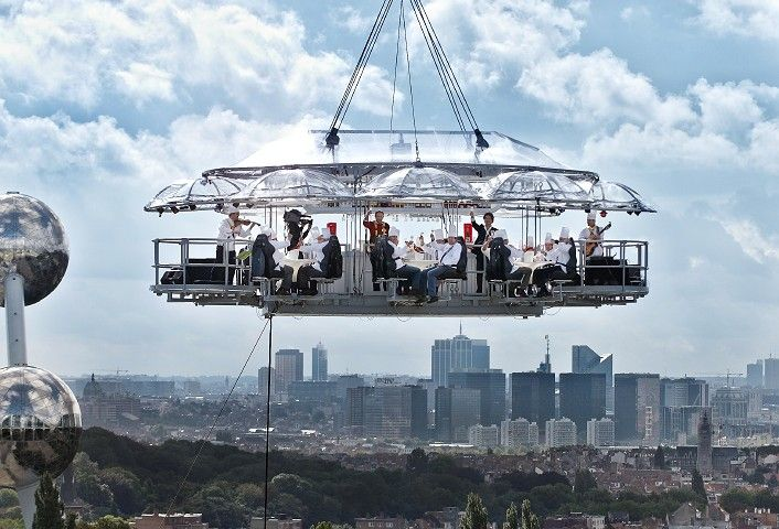 "Originally conceived in Brussels, these ""Dinner in the Sky"" restaurants can be found throughout Europe.  Yes, you're being suspended from a crane, and yes, the chef is cooking your meal up there too."