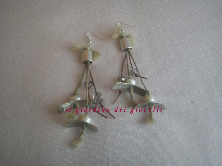metal earrings, pearls and crystals