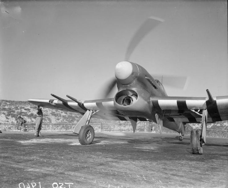 Hawker Typhoon Mark IB of No. 56 Squadron RAF runs up its engine in a revetment at Matlask, Norfolk, before taking off on a 'Rhubarb' (a harassing fighter operation) over Holland.