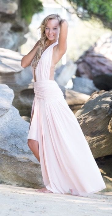 Flow in the wind, This fine Australian made gown has a mixture of a few different fabrics to make you feel amazing, hold your body in and flowing with the movement of your body