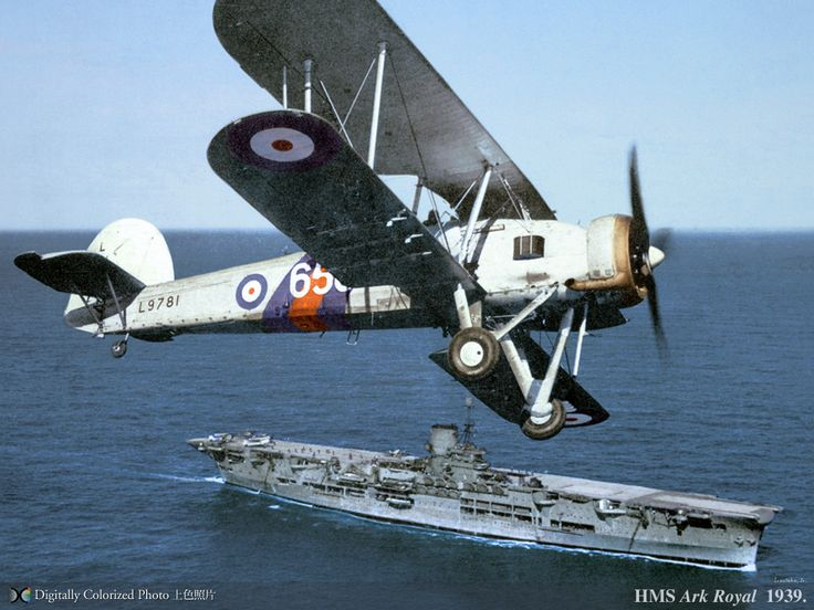 A British Swordfish over the Ark Royal.