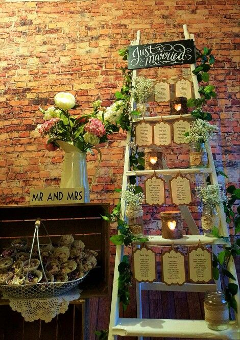 Table plan to hire, decorators ladder, rose garland, heart logs tea light holders, lace jam jars, Mr&Mrs plaque, confetti cones, crates, cream vase vintage rustic look