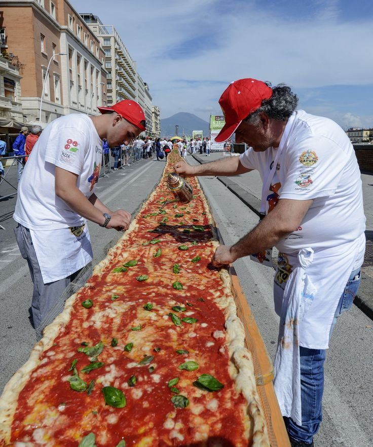 New World Record Longest Pizza | Naples set the new Guinness World Record for longest pizza with a 1.1-mile-long pie. #refinery29 http://www.refinery29.com/2016/05/111451/longest-pizza