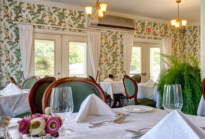 Clara's restaurant, featuring seasonally inspired fine dining, is located on the ground floor of the main house, with its dining room and patio overlooking the grounds and the bay.