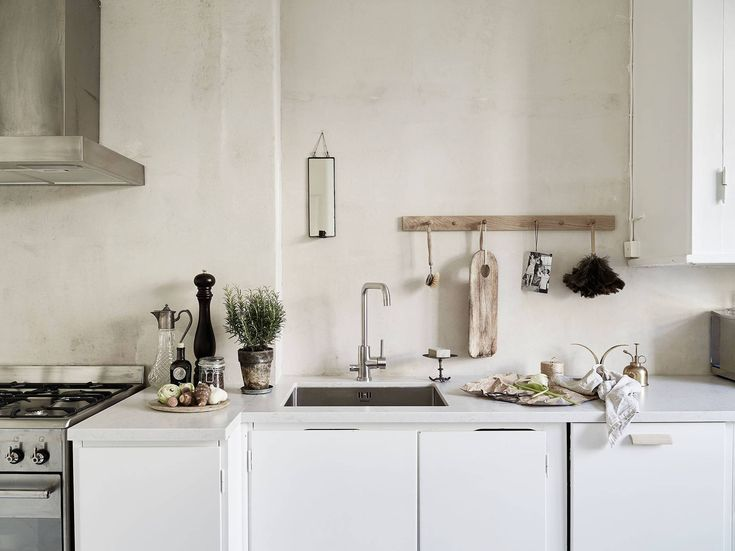 raw stone-look kitchen walls Neutral and natural - via cocolapinedesign.com