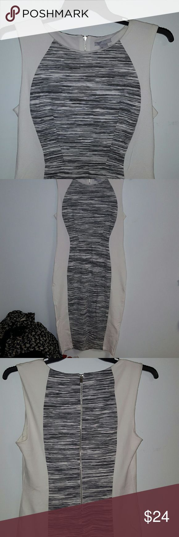H&M dress size large Office wearable. Silver zipper in the back. Fits like a pencil skirt would. NWT.  Slightly stretchy, but not sheer at all. Has a slimming effect. Would look great with or without a blazer. H&M Dresses Midi
