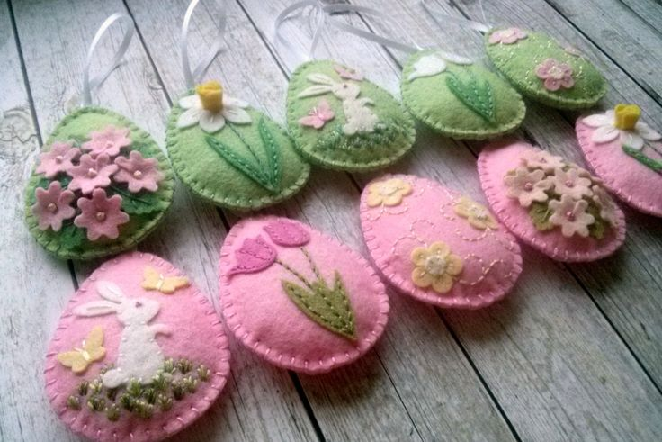 Pastel Felt Easter decoration - felt eggs with flowers and sheep/ set of 12 Listing is for 12 ornaments - 6 in baby pink - 6 in baby green Handmade from wool blend felt Size of my decorated eggs is about 2 1/8 x 2 5/8 inch (5,3 x 6,5 cm) This is size of felt egg without hanging loop Size of sheep is about 5,5 x 5,5 cm ( 2 1/8 x 2 1/4 inches) This is made to order item