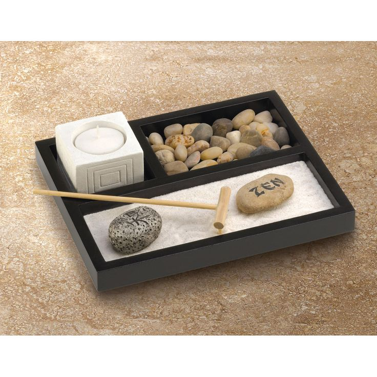 Enjoy your own private Zen garden, even if you're short on space! Nifty tabletop box contains every essential sand, rocks, candleholder and rake to create a serenely scenic escape from the everyday. D