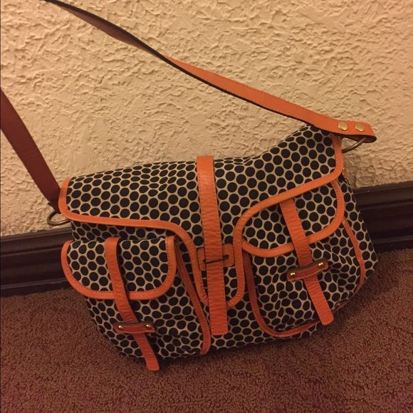 SALE! Mia Bossi diaper bag Reese tangerine diaper bag. Mia bossi. Excellent condition with internal and external pockets. Color: cream with black dots. Leather straps and trim. Made of printed wax canvas.. 2 exterior bottle holders, one interior bottle holder,  zip out lining for easy wash, cell phone holder, one private internal zipper pocket, diaper holder, baby wipe holder. Extra photos of interior in separate listing. Can purchase changing pad and stroller clips from miabossi website:)…