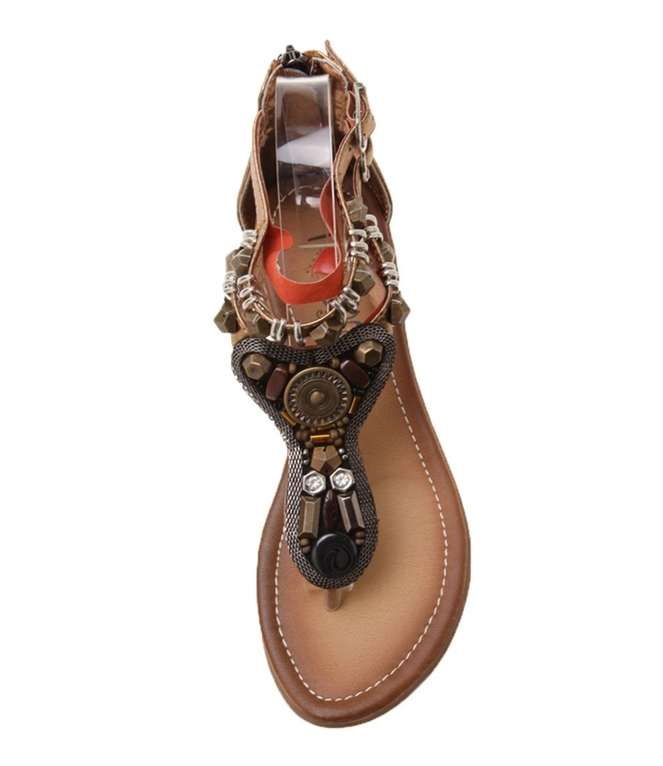 Exotic aztec style toe sandals that are beautifully crafted, featuring chainmail, beads and metal rings. They will look fabulous over a tunic and 3/4 pants or dress they up over a glamuras long tunic- Leather lining- Man made upper and sole- Colour a