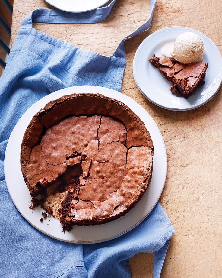 A crisp outside and gloriously fudgey centre make this easy cake the best of dinner party desserts. Make it up to two days before then serve warm with ice cream – heaven.