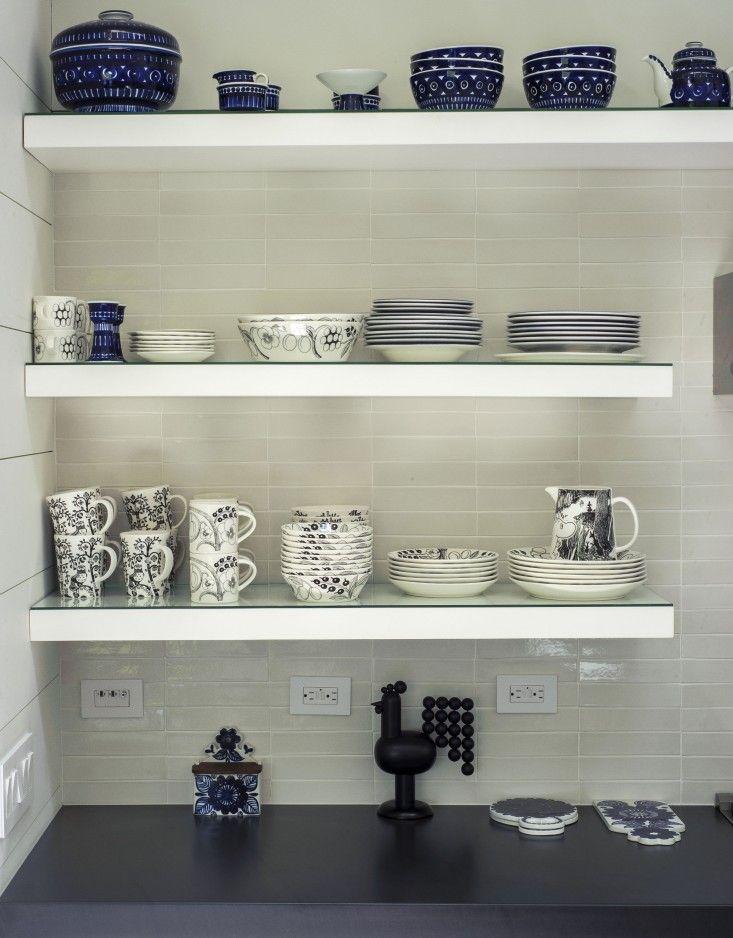 a beautiful collection of Arabia ceramics against a backdrop of stacked rectangular field tile. Tiina Laakkonen Amagansett Shelves | Remodelista