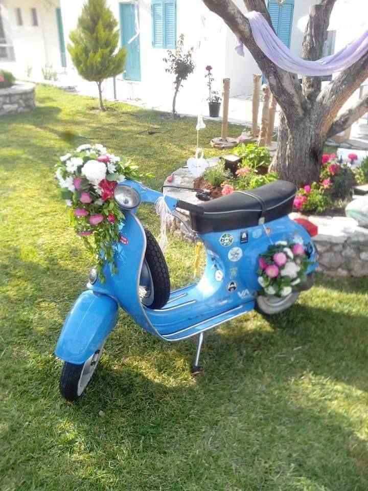 Vintage vespa scooter wedding decoration with flowers