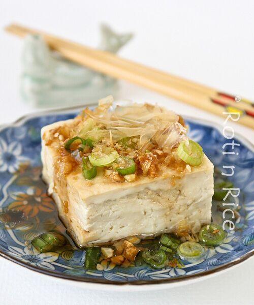 Steamed Tofu with Garlic Soy Dressing - shows an easy way to steam tofu in the microwave! silken or medium firm tofu, canola oil, fresh garlic, soy sauce, mirin, green onion, optional toppings (dried bonito shavings, sesame seeds, shichimi togarashi)