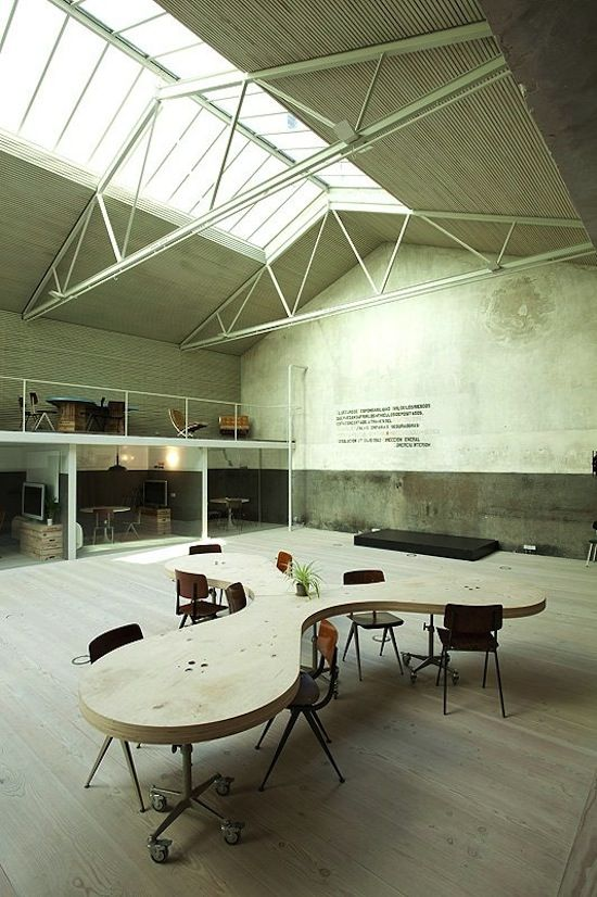 The Hub - a garage in Madrid transformed into an office space with several offices.